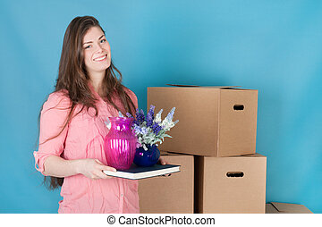Woman unpacking while moving house