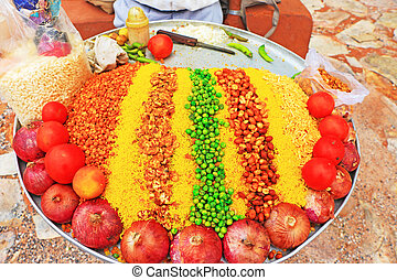 dish of spices and nuts india - indian street food vendor...
