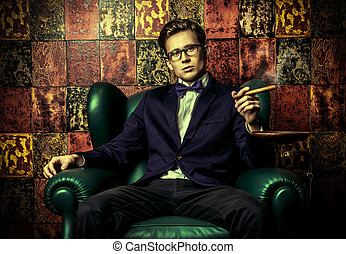 confident pose - Handsome young man in elegant suit smoking...