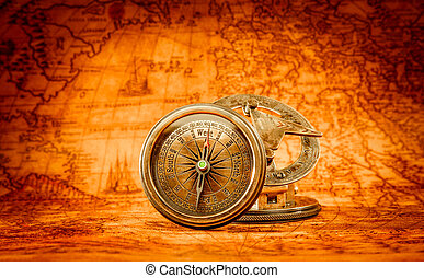 Vintage compass lies on an ancient world map - Vintage still...