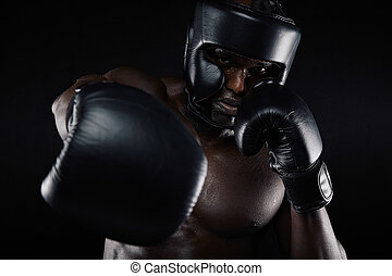 Young sportsman training boxing