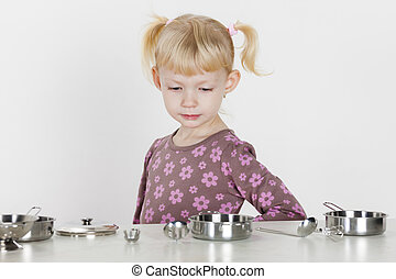little girl playing with child dish