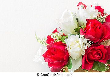 red roses and white roses artificial on a white background -...