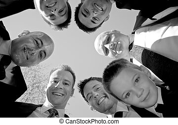 Groomsmen Huddle - A groom and his groomsmen posing together...