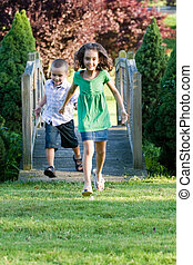 Happy Little Kids - A cute little children running happily...