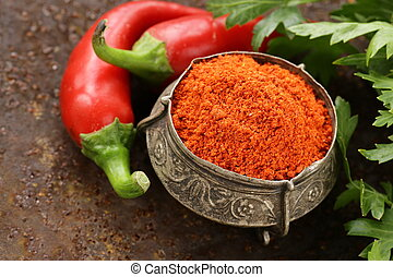 red spice paprika pepper on iron old background