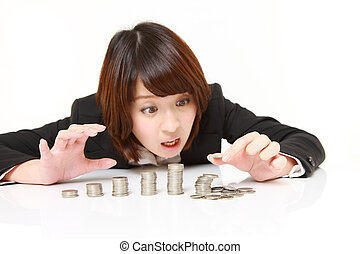 Financial collapse - studio shot of young Japanese...