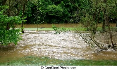 The river overflowed after heavy rains. The river name...