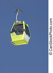 cablecar - green cablecar with blue sky