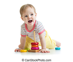 child baby playing with color pyramid toy - smiling child...