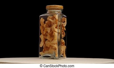 Dried apples spins in glass bottles
