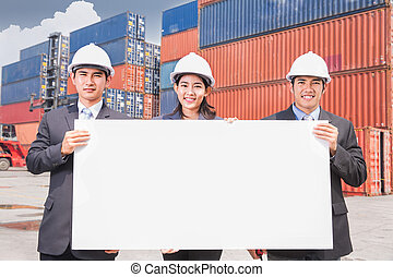 Team of young business people holding blank white board in...