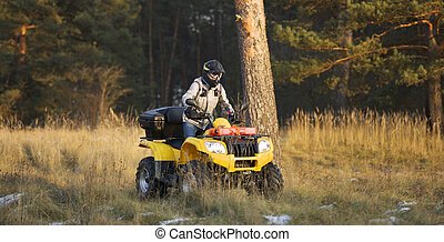 Maneuvering off-road ATV - Horizontal action shot of a man...