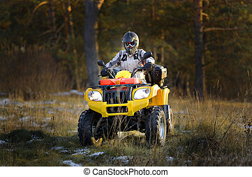 Man driving quad bike - Horizontal portrait of a man in...