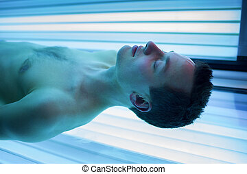Handsome young man in a sauna - Handsome young man relaxing...
