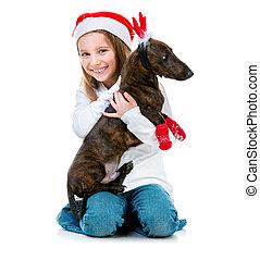 little cute girl with a dachshund