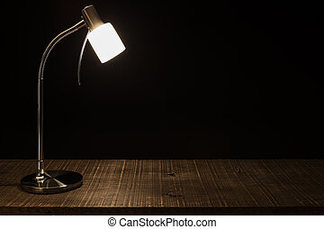 Lamp Shade on the table. In a dark background.