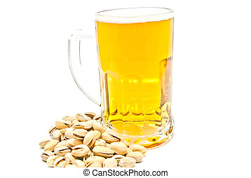 mug of beer and pistachios on white