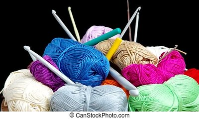 Yarn for crocheting  are rotated on the table.