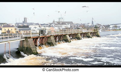 View at hydroelectric power plant on river in Ireland