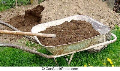 Takeaway soil in hand wheelbarrow