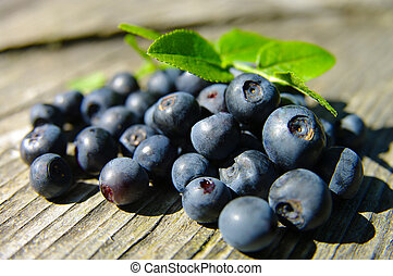 bilberry on the wooden surface