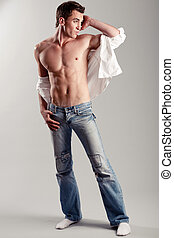 Muscular man posing - Fashion shot of a young man looking...
