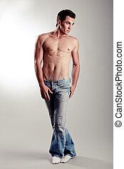 Cool guy in jeans - Shirtless young male model posing cross...