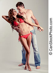 Caucasian couple posing - Handsome male model with his hand...