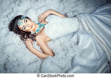 Girl on white fur. - Girl in white dress lying on white fur.