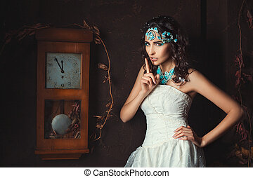 Girl near the clock - Girl stands near the old clock and...