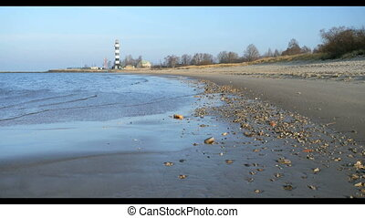 Lighthouse Sand beach in Baltic sea , Riga Latvia