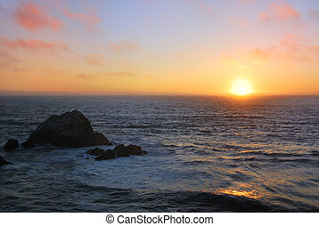Sunset at San Francisco Ocean Beach - Sunset above the wavy...