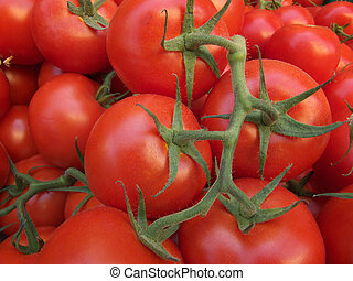 Tomatoes - an image showing some tomatoes at the market