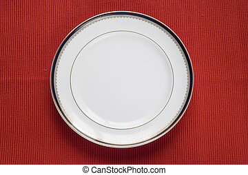 lonely plate - lonely porcelain plate over red (copy space...
