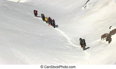 Climbers walk - Climbers go up to the mountain pass