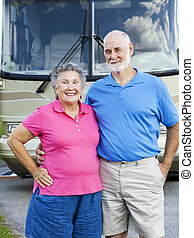 Seniors Couple with RV - Portrait of healthy retired couple...