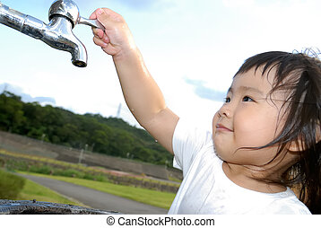 baby wash hand and turn off faucet in the outdoor - She is a...