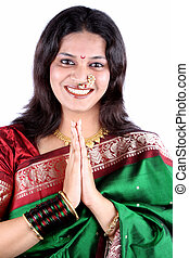 Indian Welcome - A beautiful smiling Indian woman in a...
