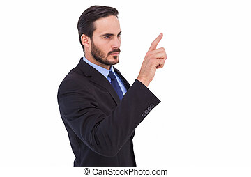 Focused businessman pointing in suit jacket on white...