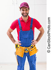 Construction worker smiling at camera in a new house