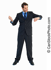 Smilling businessman watching the clock on white background