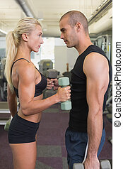 Couple exercising in gym