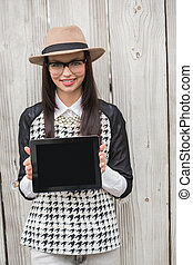 Pretty hipster showing tablet pc