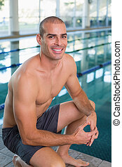 Fit swimmer by pool at leisure cent - Portrait of a fit...