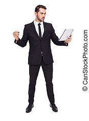 Focused businessman holding pen and notebook on white...