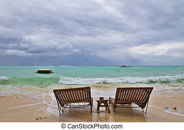 Two Beachbeds on Rainy Beach before Storm