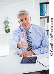 Happy businessman offering his hand