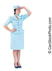 Pretty air hostess - Pretty air hostess with hand on hip on...