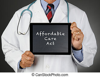 Doctor Tablet Computer Affordable Care Act - Closeup of a...